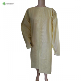 China Disposable yellow SMS isolation gown with thumb hole factory
