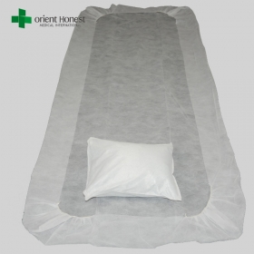 China Flame resistant disposable pillow cover and bed sheet , cheap price disposable hotel bed sheets , disposable non woven bed sheet set manufacturer factory