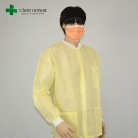 China disposable long sleeve lab coats,disposable surgical coat for hospital,three pocket yellow lab coat factory